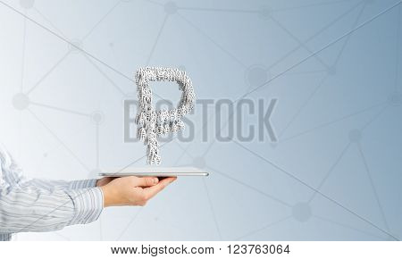 Hand of businessman showing tablet pc with rouble currency sign