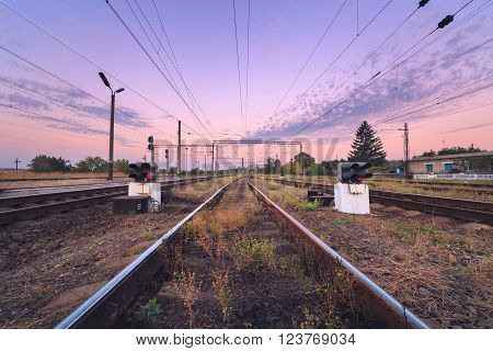 Railway Station And Traffic Light At Colorful Sunset. Railroad