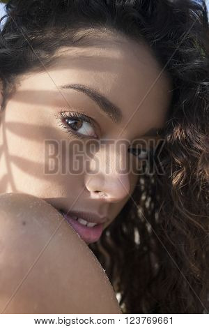 Young Beautiful Girl With Brown Eyes Lying Close Up