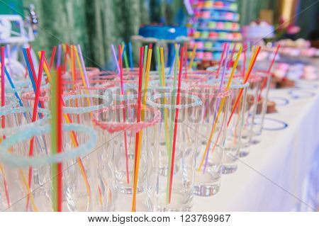 Empty glasses for drinks with a straw on party.