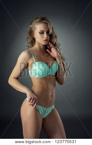 Attractive model posing in sexy lingerie light-blue color