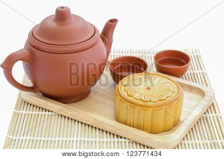 Moon Cake with tea set on white background