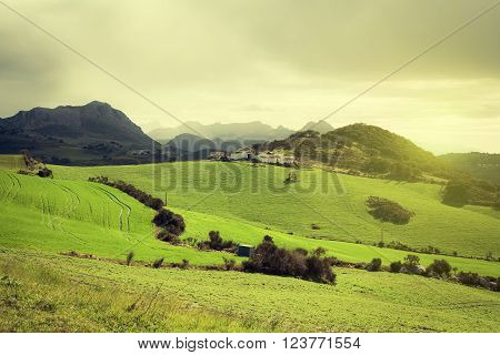 View of farmlands and misty mountains from El Torcal, Antequera. Spain.