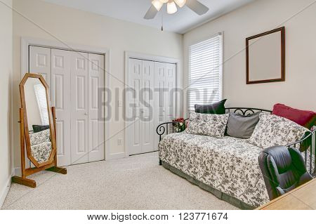 bedroom and home office in neutral colors