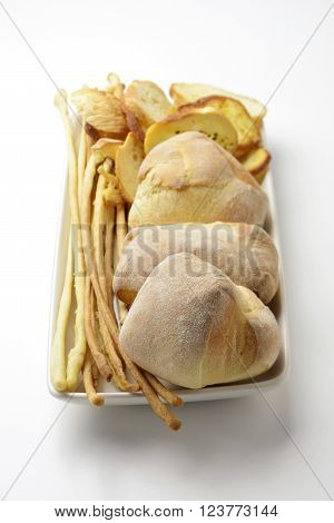 Rectangular dish with bread and breadsticks on white ** Note: Soft Focus at 100%, best at smaller sizes