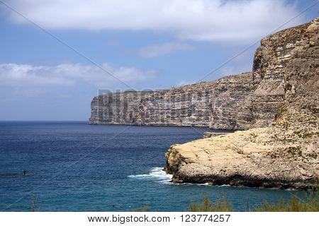 Cliffs of Gozo Island on cloudy day, Malta