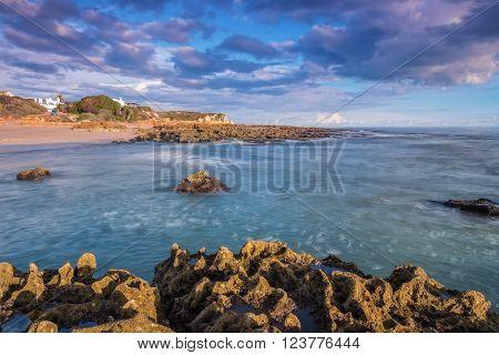 Sea waves and rocks. Gale Beach Albufeira.