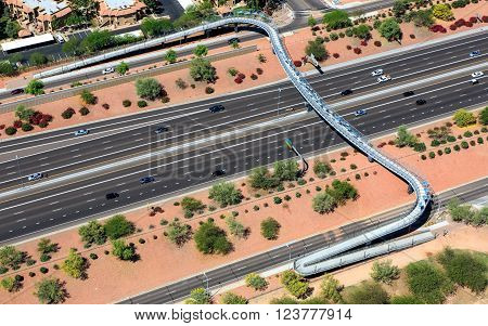 A pedestrian, cyclist bridge spanning the Loop 101 freeway in Chandler, Arizona