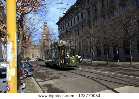 MILAN ITALY - FEBRUARY 08 2010 Old traditional tram ATM on the street of Milan used as moving restaurant ATMOSFERA on February 8 2015. Milan tramway network operation since 1881.