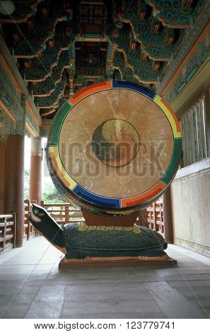 GYEONGJU CITY, NORTH GYEONGSANG PROVINCE / KOREA - CIRCA 1987: A sacred drum resting on the back of a large turtle under a roof at the historic Bulguksa Buddhist temple, which is a UNESCO Heritage Site.