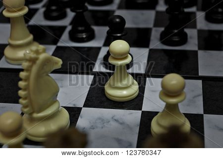 Chess. White Pawn on the board. Set of chess figures. Playing position.