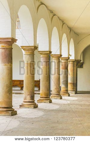 Perspective view of colonia style columns with arc from inside of San Francisco church in the historic center of Quito, Ecuador.