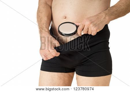 Man With Magnifying Glass Looking Into His Boxer Underwear
