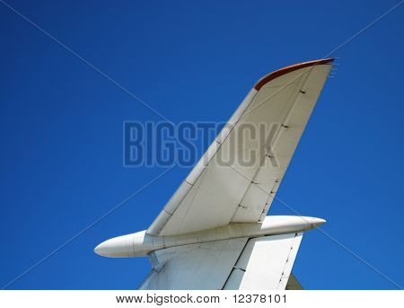 Tailfin of plane against sky