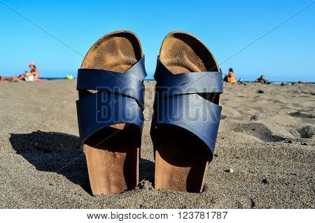 Photo Picture of Slippers on the Sand Beach