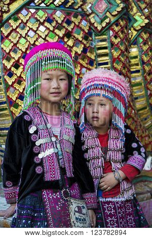 CHIANG MAI, THAILAND- JANUARY 31, 2016: Unidentified children in hilltribe costume at Wat Phra Doi Suthep near Chiang Mai. Wat Phra Doi Suthep is on top of a mountain just outside Chiang Mai one of the most important and extravagant of all Thailand's Budd