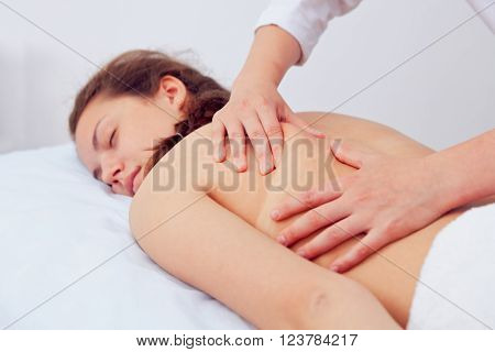 Spa Woman. Beauty Treatment. Beautiful Young Healthy Caucasian Girl Relaxing With Hand Massage Procedure In The Spa Salon. Masseur Massaging Her Back. Body Care. Skin Care, Wellness, Wellbeing