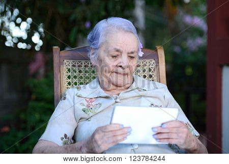 Grandma using a tablet for video call in park