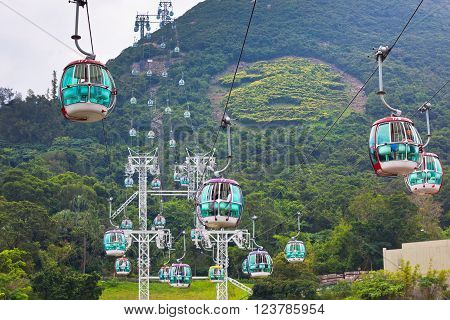 HONG KONG HONG KONG - OCTOBER 01: cable cars over tropical trees in Hong Kong on October 01 2012