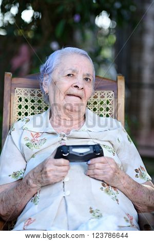 grandma with joystick exciting play videogames outside