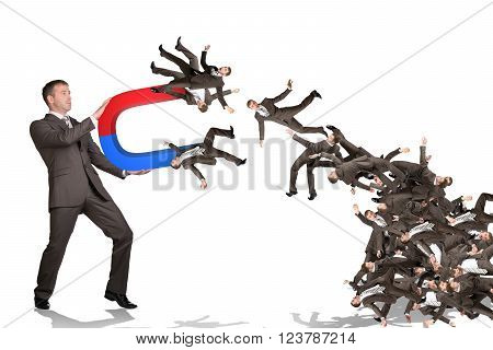 Businessman catching people on magnet isolated on white background