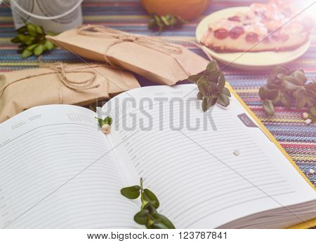 notepad paper envelope and piece of pie on the colorful tablecloth. sunlight ** Note: Visible grain at 100%, best at smaller sizes