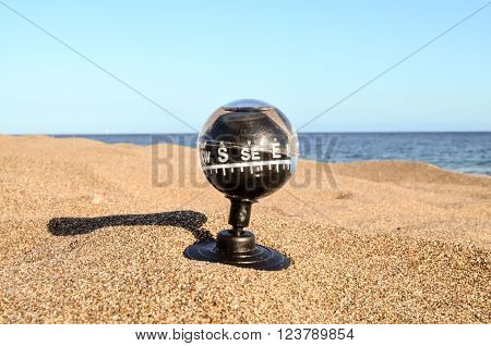 Close up of a Compass on the Sand Beach ** Note: Soft Focus at 100%, best at smaller sizes