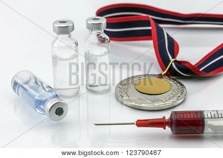 Doping in sport concept, Gold medal next to instruments for dope