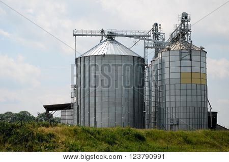Steel grain elevator against the sky (Poland)