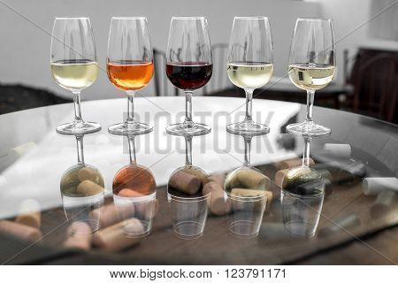 Set of six different wines in wineglasses on the table for degustation