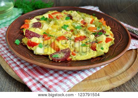 Frittata with peppers salami and cheese Italian breakfast