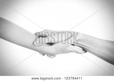 Two hands reaching toward each other. Helping concept. Vintage tone