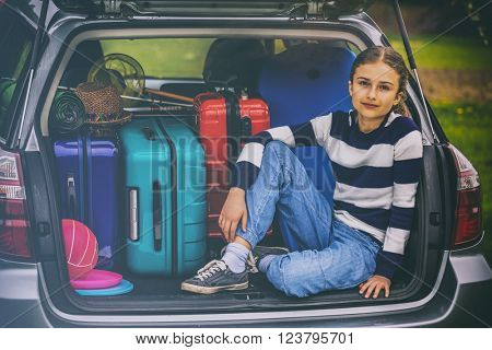Summer vacation, young girl ready for travel for family vacation (filtered)