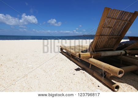 Relaxing couch chair on white sandy beach at Philippines