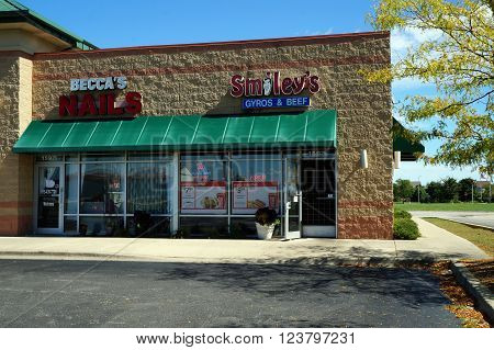 PLAINFIELD, ILLINOIS / UNITED STATES - SEPTEMBER 20, 2015: One may have one's nails trimmed at Becca's Nail Salon, and have a meal at Smiley's Restaurant, in a Plainfield strip mall.