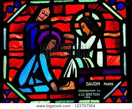 AMIENS, FRANCE - FEBRUARY 9, 2013: Stained glass window depicting Jesus washing the feet of the apostle Peter at the Last Supper on Maundy Thursday, in the Cathedral of Our Lady of Amiens, France.