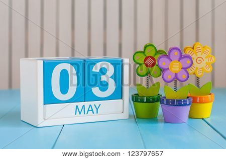 May 3rd. Image of may 3 wooden color calendar on white background with flower. Spring day, empty space for text.  International or World Press Freedom Day.