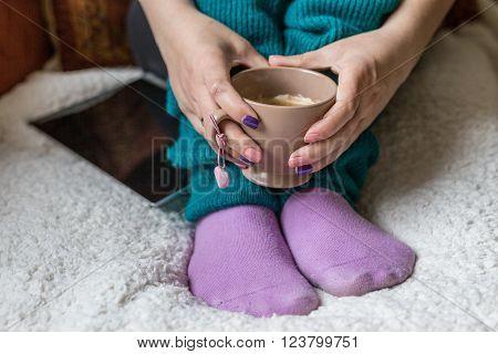 Female Hands Holding Teacup