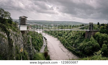 The Clifton Suspension Bridge is spanning the Avon Gorge and the River Avonin Bristol England.