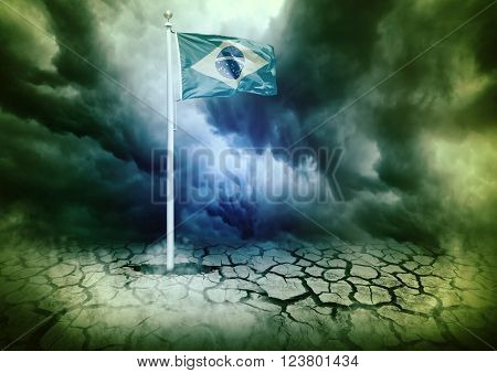 mast with the Brazil flag coming out of hole in cracked ground