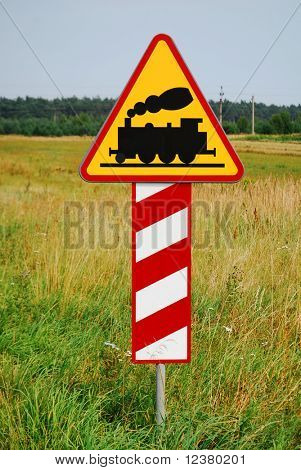 Hazard railway crossing sign ahead. Yellow railroad tracks sign.