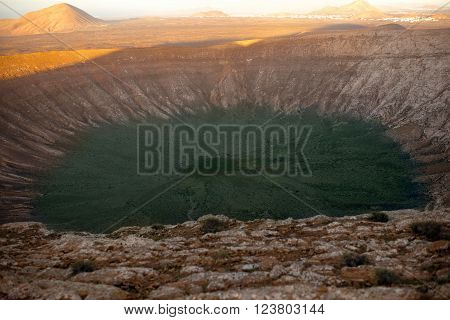 View on the crater of Caldera Blanca volcano on the sunset on Lanzarote island in Spain