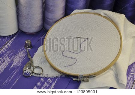 items for sewing and crafts: hoop, thread, scissors