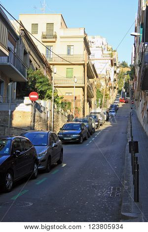 Barcelona, Catalonia, Spain - December 12, 2011: Road To Park Guell In Barcelona With Parked Cars