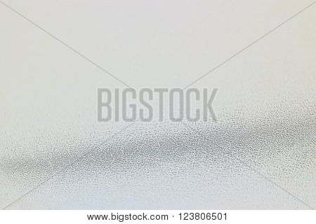 Neutral grey background with grainy texture wave in horizontal 3:2 format.
