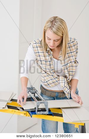 Home Improvement - Handywoman Cutting Tile