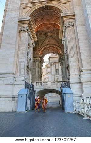 Vatican Italy - June 26 2014: Members of the Pontifical Swiss Guard stand guard in Saint Peters Basilica in Vatican