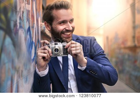 Handsome man with vintage camera
