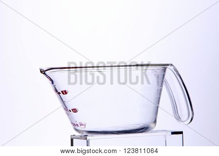 Glass measuring cup isolated on white background.