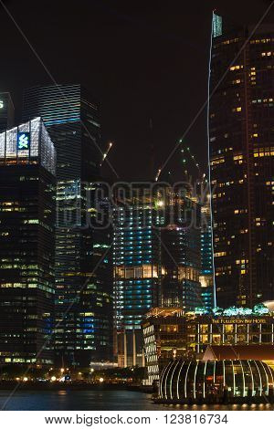 Singapore - Mar 26, 2016: Night view of Marina Bay area surrounded by modern buildings including hotels, restaurants and mega office towers.